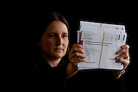 A member of counting postal votes holding envelop votes.<br /> Potocall as postal votes processed. Edinburgh council workers begin to verify the first votes submitted by post at Royal Highland Centre, Ingliston<br /> Pako Mera/Universal News And Sport (Europe) 12/09/2014