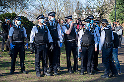 © Licensed to London News Pictures. 27/02/2021. London, UK. Police officers arrive to break up an anti-vaccination and anti-lockdown demonstration in Bishops Park area of Fulham, West London. The group  against the current tier regulations and anti-vaccination for the Covid-19 disease credit: Ray Tang/LNP