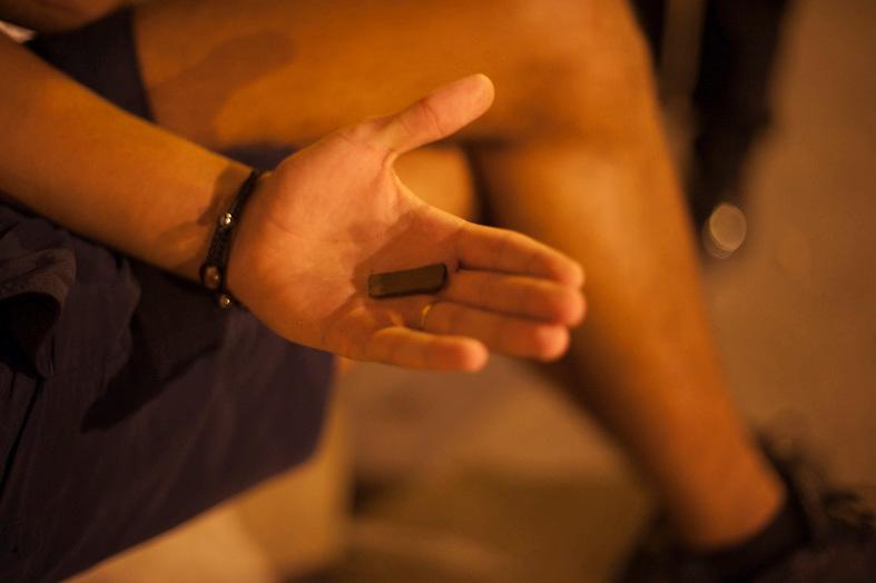 Dealer (18 years) selling  hashish, city center Marseille. ..Marseilles is one of the poorest districs in France, used as a bases for drug traffic on a large scale, leading to murders among groups of competing dealers. 19 people were shot dead in drugs related killings in 2012, mainly with Kalachnikovs....Dealer (18 ans)  de hashish montre une barette a vendre, centre ville marseille. .....Jonge drugsdealer (18 jaar) op zijn verkoopplek in het centrum van Marseille. Hij haalt een omzet van 200 euro per dag.