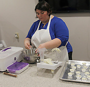 """Kaela Creonte, one of two bakers at Whisker Bones, prepares """"pupcake"""" icing. The dog-friendly organic ingredients the company uses contain no preservatives or additives."""