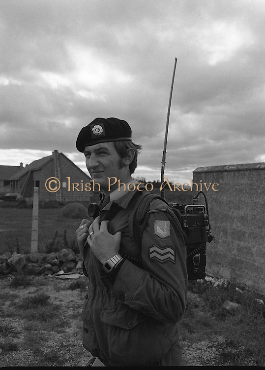 """Army Exercises In Co Sligo.   (L37).<br /> 1977.<br /> 05.09.1977.<br /> 09.05.1977.<br /> 5th September 1977.<br /> The Army Reserve Brigade, which is made up of regular units from the Southern Command, are conducting a series of conventional military exercises in counties Mayo and Sligo from the 5th to the 9th September. Approximately 1,500 men and 250 vehicles are involved. The exercise was codenamed """"Humbert"""" after an ill fated expedition by French troops into Ireland on 23rd August 1798. 1,100 French troops with Irish support took on the incumbent English forces. After some initial success they were defeated at Ballinamuk on 8th Sept 1798 by the army of Cornwallis.<br /> <br /> Corporal John O'Leary, Observer Company,First Batallion is pictured at the military exercises."""