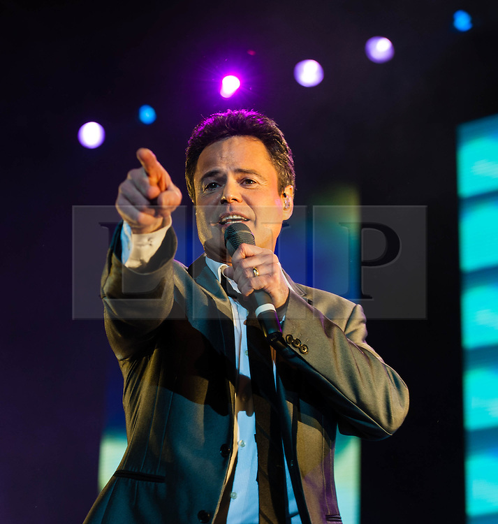 """© Licensed to London News Pictures. 20/01/2013. London, UK.   Donny Osmond of Donny and Marie Osmond performing live at The O2 Arena, on the opening night of their Donny & Marie Live tour Sunday 20 January 2013.  .Donald Clark """"Donny"""" Osmond (born December 9, 1957) is an American singer, musician, actor, dancer, radio personality, and former teen idol. Donny Osmond has also been a talk and game show host, record producer and author. In the mid 1960s, he and four of his elder brothers gained fame as The Osmonds on the long running variety program, The Andy Williams Show. Donny went solo in the early 1970s covering such hits as """"Go Away Little Girl"""" and """"Puppy Love""""...Olive Marie Osmond (born October 13, 1959) is an American singer, actress, doll designer, and a member of the show business family The Osmonds. Although she was never part of her family's singing group, she gained success as a solo country music artist in the 1970s and 1980s. .For over thirty-five years, Donny and Marie have gained fame as Donny & Marie, partly due to the success of their 1976-79 self-titled variety series, which aired on ABC. The duo also did a 1998-2000 talk show and have been headlining in Las Vegas since 2008.   Photo credit : Richard Isaac/LNP"""