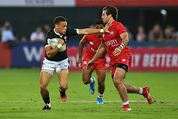 Jay Jones of Wales evades the tackle of Patrick Kay of Canada <br /> <br /> Photographer Craig Thomas/Replay Images<br /> <br /> World Rugby HSBC World Sevens Series - Day 2 - Friday 6rd December 2019 - Sevens Stadium - Dubai<br /> <br /> World Copyright © Replay Images . All rights reserved. info@replayimages.co.uk - http://replayimages.co.uk