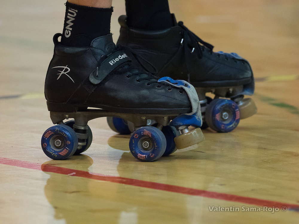 Detail of the skates of a player of roller derby.