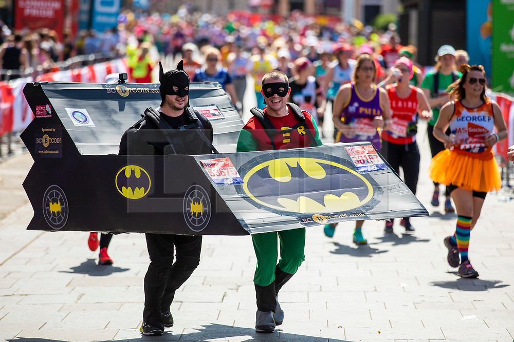 © Licensed to London News Pictures. 22/04/2018. London, UK. Two runners dressed as Batman and Robin run with their Batmobile past the Cutty Sark in Greenwich during the Virgin Money London Marathon 2018. Photo credit: Rob Pinney/LNP