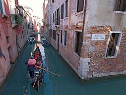 Gondola on small canal in Venice Italy