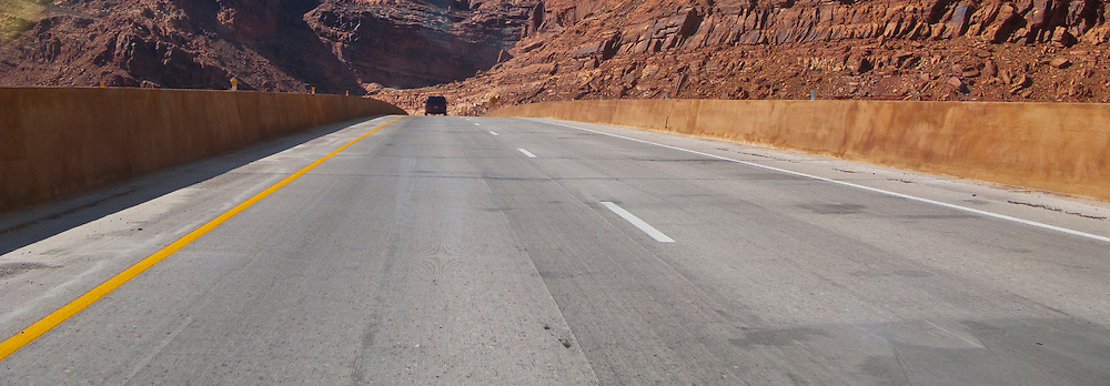 US 191 enters a slickrock canyon as it passes by the entrance to Arches National Park     panorama
