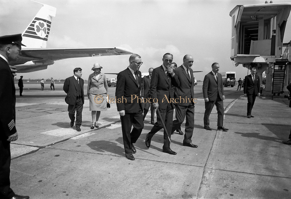 09/08/1967<br /> 08/09/1967<br /> 09 August 1967<br /> His Royal Highness Prince Bernhardt of the Netherlands arrival at Dublin Airport. The prince arrived from Paris on his own private plane to attend the RDS Horse Show in Dublin. Photo shows the prince being accompanied from his plane by Mr. Frank Aiken, Minister forExternal Affairs, The Netherlads Ambassador, J.I.M. Wesling; Mrs Wesling; Mr. John E. Wylie, Secretary, Royal Dublin Society; Mr. Paul Keating, Chief of Protocol and Airport Officials.