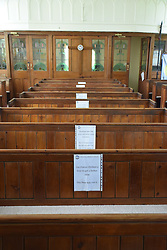 Witty social distancing signs in the Moravian church, Brockweir, Wye Valley on Welsh border, Gloucestershire, England May 2020