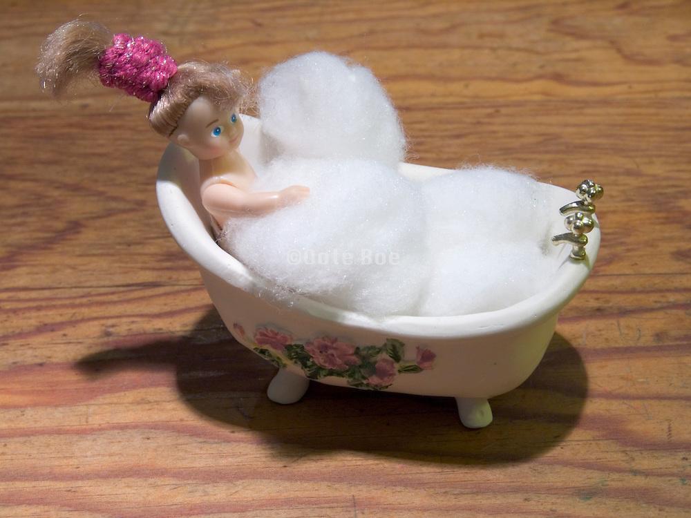 doll in bath tub