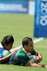 Paul Delport goes over for a try for South Africa during the XIX Commonwealth Games 7s rugby match between South Africa and India held at The Delhi University in New Delhi, India on the  11 October 2010..Photo by:  Ron Gaunt/photosport.co.nz