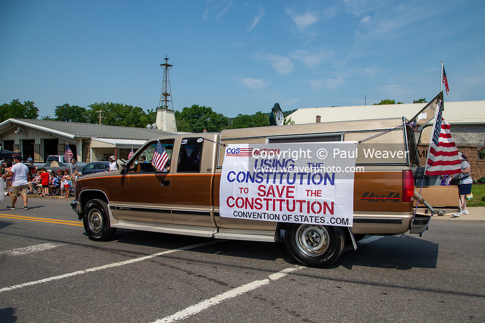 A pickup truck with a banner from a group advocating for a convention of states to change the US Constitution drives in an Independence Day parade in Millville, Pennsylvania on July 5, 2021.
