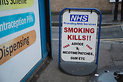 NHS smoking kills sign outside a pharmacy in London, England, United Kingdom.
