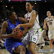 Brandi Harvey-Carr, (left), DePaul, fights for possession with Gabby Williams, UConn, during the UConn Vs DePaul, NCAA Women's College basketball game at Webster Bank Arena, Bridgeport, Connecticut, USA. 19th December 2014