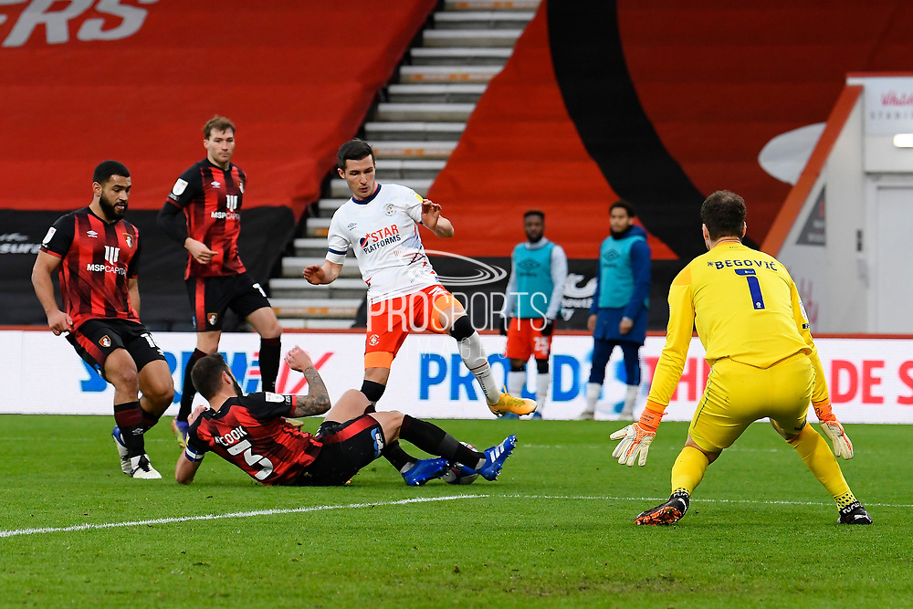 Steve Cook (3) of AFC Bournemouth tackles Dan Potts (3) of Luton Town during the EFL Sky Bet Championship match between Bournemouth and Luton Town at the Vitality Stadium, Bournemouth, England on 16 January 2021.