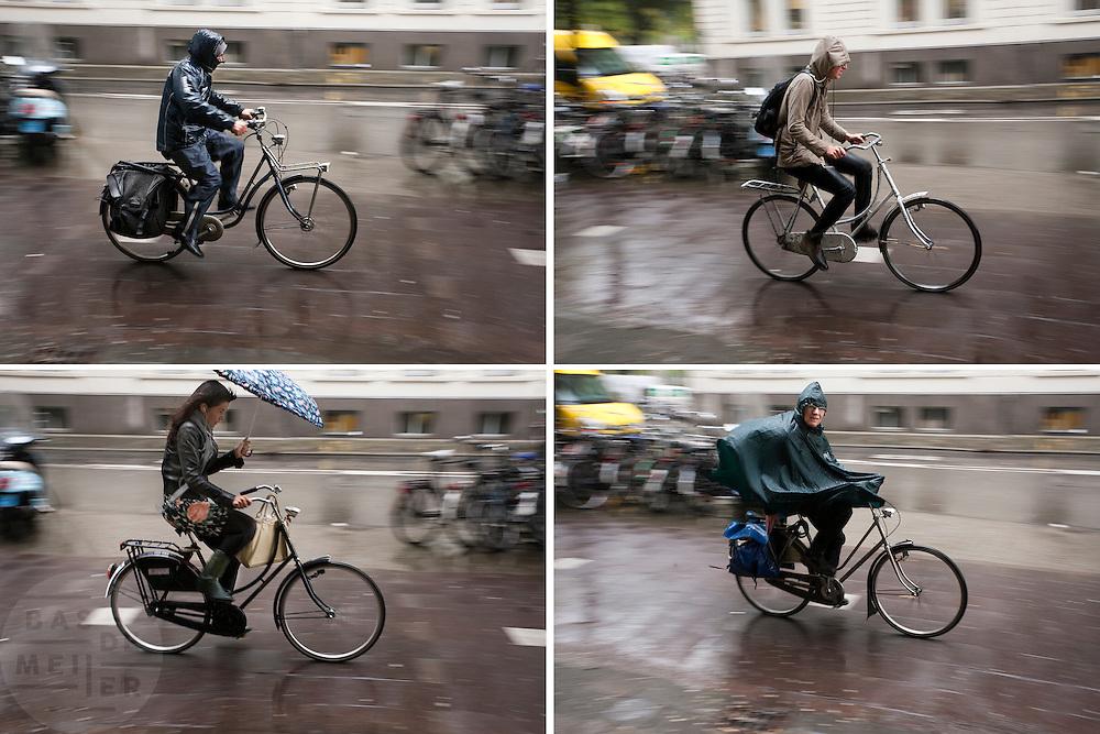 Fietsers rijden bij het station in Utrecht door de stromende regen. Na een aantal mooie dagen is de herfst nu echt aangebroken. Dat betekent dat fietsers zich weer moeten wapenen tegen de regen met regenjas, paraplu of poncho.<br /> <br /> Cyclists are riding in the rain.