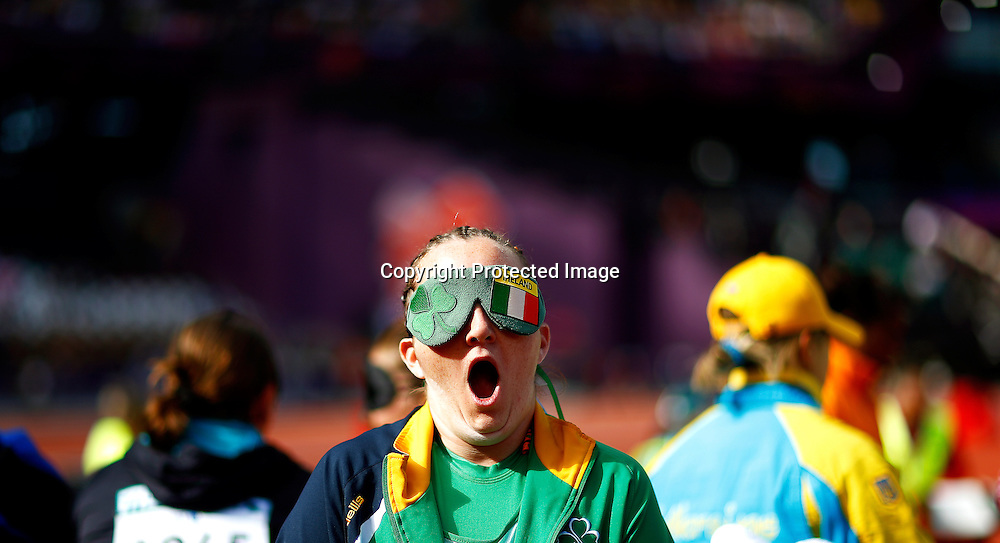 Nadine Lattimore of Ireland yawns while waiting for her turn during the women's Shot Put F11/12 final at the Olympic Stadium during the London 2012 Paralympic Games in London, Britain, 05 September 2012.  EPA/KERIM OKTEN