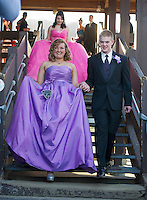 """Jasmyn Murgatory and John Nercuril join in the march at Gunstock for Laconia High School's """"Night of Diamonds"""" junior prom Friday evening.  (Karen Bobotas/for the Laconia Daily Sun)"""