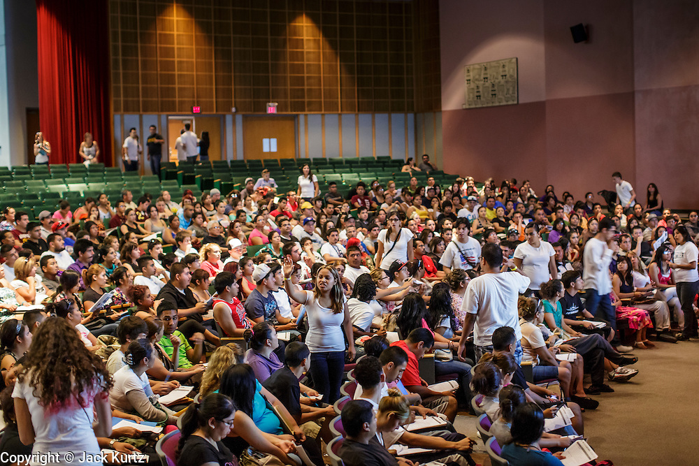 """25 AUGUST 2012 - PHOENIX, AZ: Immigrants listen to volunteers explain how to complete the Department of Homeland Security forms needed to apply for deferred action status in a workshop Saturday. Hundreds of people lined up at Central High School in Phoenix to complete their paperwork to apply for """"Deferred Action"""" status under the Deferred Action for Childhood Arrivals (DACA) program announced by President Obama in June. Volunteers and lawyers specialized in immigration law helped the immigrants complete the required paperwork. Under the program, the children of undocumented immigrants brought to the US before they turned 16 years old would not be subject to deportation if they meet a predetermined set of conditions.     PHOTO BY JACK KURTZ"""