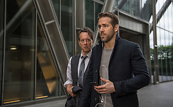 """Richard E. Grant as """"Seifert"""" and Ryan Reynolds as """"Michael Bryce"""" in THE HITMAN'S BODYGUARD. Photo by Jack English."""
