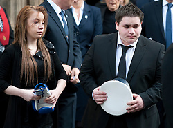 © London News Pictures. 10/03/2012.  Newcastle, UK. L to R Mia Rathband (Daughter) and Ashley Rathband (Son) leaving Newcastle Cathedral in Newcastle upon Tyne carrying PC Davis Rathband police hat following  a formal police memorial service in the memory of PC David Rathband, who was found dead in his Northumberland Home on February 29. PC David Rathband was left blind after being shot in the face by gunman Raoul Moat.  Photo credit : Ben Cawthra/LNP