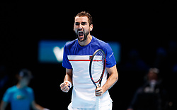Marin Cilic celebrates taking the opening set during day three of the NITTO ATP World Tour Finals at the O2 Arena, London.