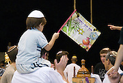 Israel, Kibbutz Ashdot Yaacov, Simchat Torah celebrations marking the conclusion of the annual cycle of public Torah readings, Child with flag