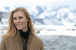 woman outdoors looking off and smiling