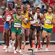 TOKYO, JAPAN August 3:   Lesiba Mashele of South Africa, Joshua Cheptegei of Uganda and Paul Chelimo of the United States in action during the Men's 5000m round one heat two race at the Olympic Stadium during the Tokyo 2020 Summer Olympic Games on August 3rd, 2021 in Tokyo, Japan. (Photo by Tim Clayton/Corbis via Getty Images)