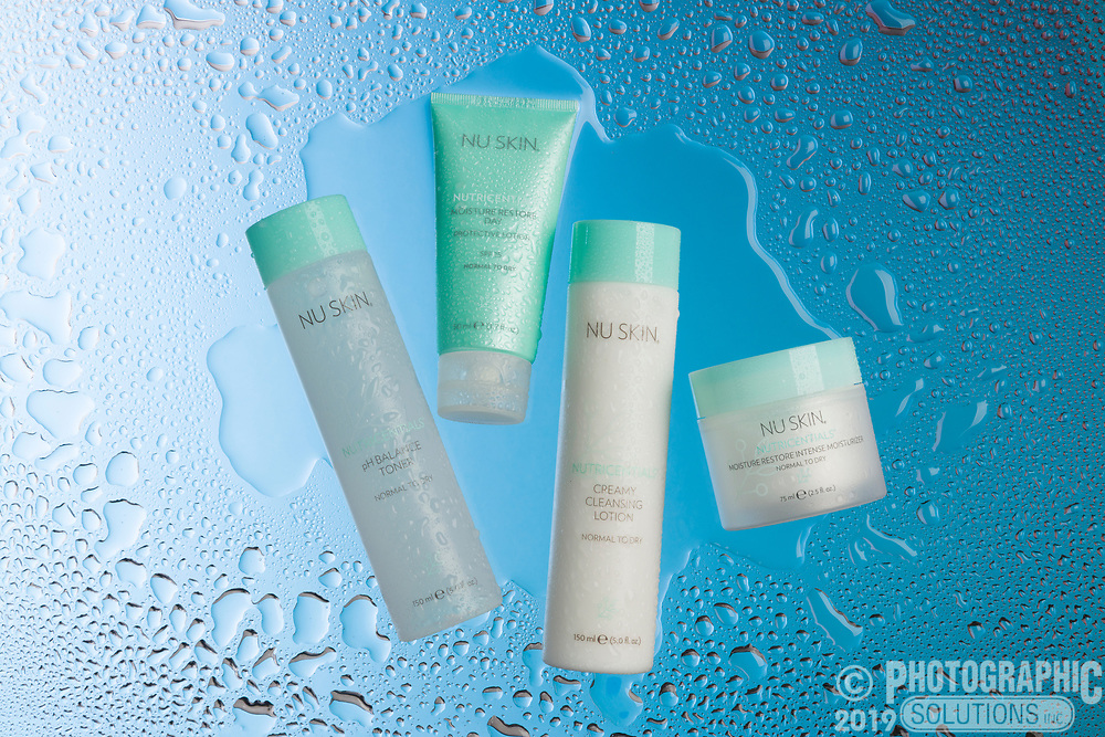 Water droplets on nuSkin products, placed on Plexiglas and back-lit.