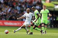 Andre Ayew of Swansea city is challenged by Fernandinho of Manchester city.Barclays Premier league match, Swansea city v Manchester city at the Liberty Stadium in Swansea, South Wales on Sunday 15th May 2016.<br /> pic by Andrew Orchard, Andrew Orchard sports photography.