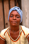 CUBA, HAVANA (HABANA VIEJA) Portrait of a young woman wearing a traditional head scarf