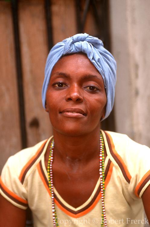 CUBA, HAVANA (HABANA VIEJA) Portrait of a young woman wearing a traditional head scarf