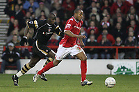Photo: Pete Lorence.<br />Nottingham Forest v Charlton Athletic. The FA Cup. 06/01/2007.<br />Junior Agogo charges ahead of Souleyman Diawara.