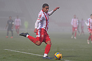 Stevenage defender Luther Wildin(2) plays a pass during the FA Cup match between Stevenage and Swansea City at the Lamex Stadium, Stevenage, England on 9 January 2021.