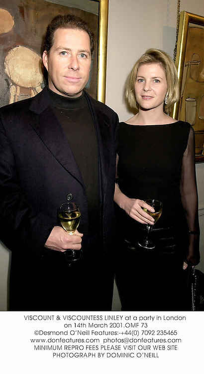 VISCOUNT & VISCOUNTESS LINLEY at a party in London on 14th March 2001.OMF 73