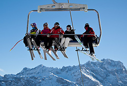 23.01.2011, Tofana, Cortina d Ampezzo, ITA, FIS World Cup Ski Alpin, Lady, Cortina, SuperG, im Maria Riesch (GER, #17) am Sessellift mit Skitouristen // Maria Riesch (GER) during FIS Ski Worldcup ladies SuperG at pista Tofana in Cortina d Ampezzo, Italy on 23/1/2011. EXPA Pictures © 2011, PhotoCredit: EXPA/ J. Groder