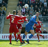 Photo: Chris Ratcliffe.<br />Leyton Orient v Grimsby Town. Coca Cola League 2. 17/04/2006.<br />Gary Jones (R) of Grimsby heads the ball on under close attention from Donny Barnard (L) and Adam Tann (C) of Leyton Orient