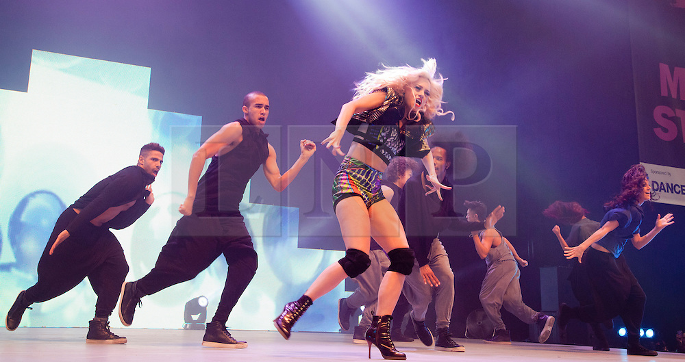 """© Licensed to London News Pictures. 09/03/2012. London, England. Kimberly Wyatt, """"Got to Dance""""-Judge and former """"Pussycat Doll"""" performs at the UK's biggest dance event """"Move It"""" at London Olympia on 9 March with dancers from D.inc. Photo credit: Bettina Strenske/LNP"""