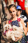 A young girl and her do dressed in patriotic costume during the annual I'On Community Independence Day Parade on July 4, 2012 in Mt Pleasant, South Carolina.