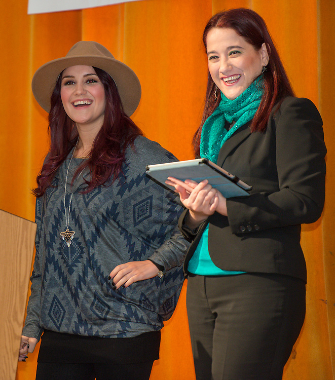 """Telenovela actress Dulce Maria, left, comments with Principal Rosa Hernandez, right, during a Televisa Foundation """"Live the Dream"""" event at Burbank Middle School, December 9, 2013."""