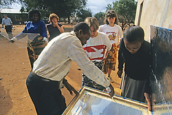 Monique Nditu & Shay And Earthwatchers Building Solar Oven