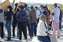 RUSTENBURG SOUTH AFRICA - MAY 18: A general view of protesters from the Seraleng mining community in Rustenburg, South Africa. Seraleng residents gathered at Sibanye k5 mine shaft Communities in the area alleged complaints of food parcel corruption by a local ward councillor. Grievances also included concerns with unemployment, loss of business and access to a social labour plan. (Photo by Gallo Images/Dino Lloyd)