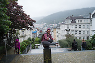 Omar poses for a photo on a hill above Bergen's city centre, on his first morning seeing the city in daylight.