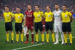 Referees with Serbian referee Milorad Mazic and teams captains Jordan Henderson of Liverpool and Sergio Ramos of Real Madrid prior to the UEFA Champions League final football match between Liverpool and Real Madrid at the Olympic Stadium in Kiev, Ukraine on May 26, 2018.Photo by Sandi Fiser / Sportida