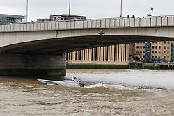 © Licensed to London News Pictures. 05/09/2016. LONDON, UK.  Bladerunner passing under London Bridge on the River Thames. The Royal Navy test out Bladerunner, their new prototype high speed drone speedboat on the River Thames in London this afternoon ahead of a major exercise. It is part of the Royal Navy's Unmanned Arrior program, which seeks to find an edge in the field of naval combat.  Photo credit: Vickie Flores/LNP