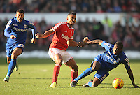 Nottingham Forest's Michael Mancienne (C) and Birmingham City's Clayton Donaldson in action during todays match  <br /> <br /> Photographer Jack Phillips/CameraSport<br /> <br /> Football - The Football League Sky Bet Championship - Nottingham Forest v Birmingham City - Saturday 28th December - The City Ground - Nottingham<br /> <br /> © CameraSport - 43 Linden Ave. Countesthorpe. Leicester. England. LE8 5PG - Tel: +44 (0) 116 277 4147 - admin@camerasport.com - www.camerasport.com