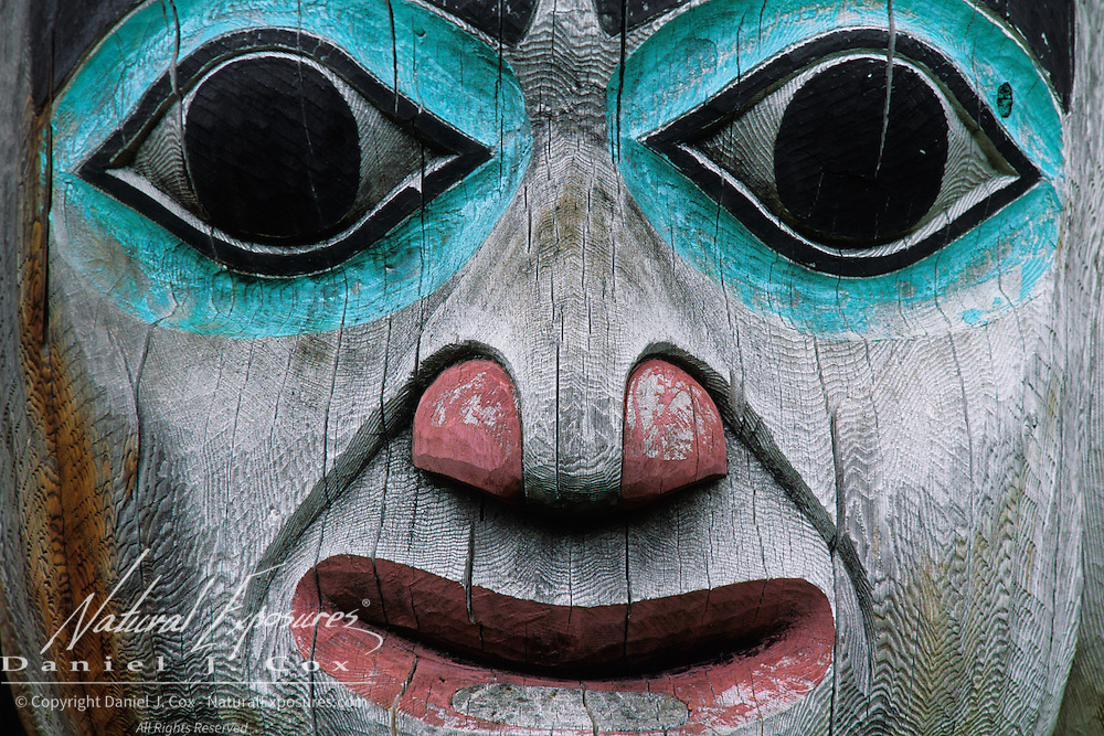 A wood-carved face on a totem pole in Juneau, Alaska.