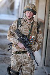 Prince Harry patrols the deserted town of Garmisir close to FOB Delhi (forward operating base) while posted in Helmand Province in Southern Afghanistan.