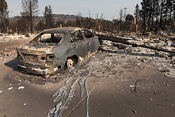 Harden pools of melted aluminum testify to the intensity of the fires that hit Santa Rosa, California.